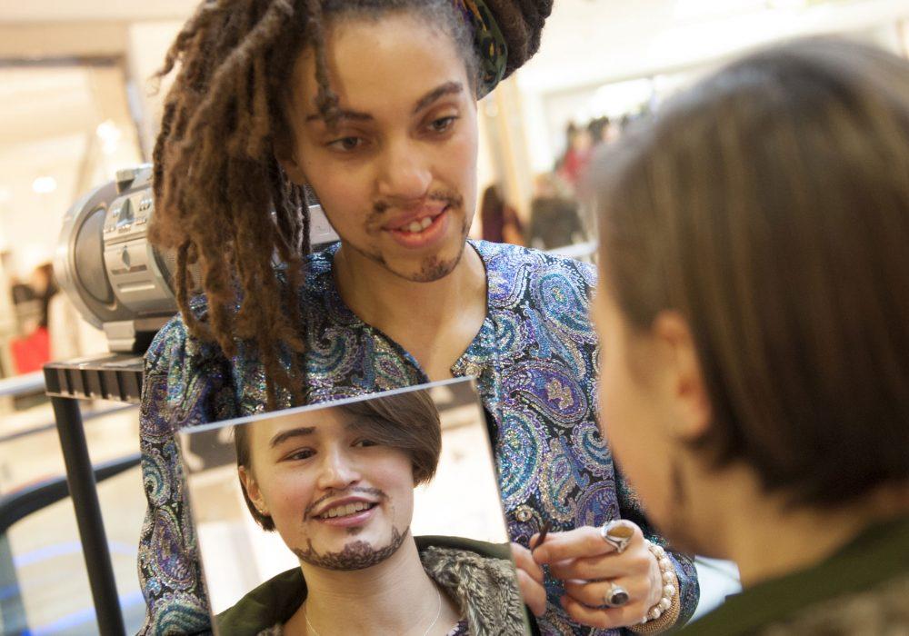 Women with beards looking in mirror